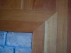 Old scuffed corner hardwood flooring