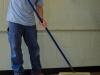 Applying new finish to hardwood floors with brush